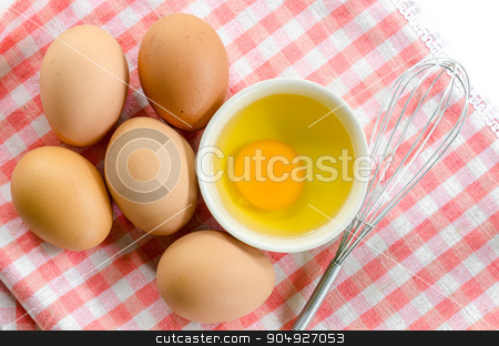 Top view of eggs. stock photo, Top view of eggs on tablecloth. by Miss. PENCHAN  PUMILA