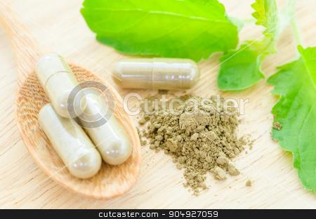 herbal medicine in capsules. stock photo, herbal medicine in capsules with green leaf on wooden background. by Miss. PENCHAN  PUMILA