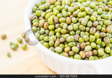 Healthy vegetarian super foods ingredient mung beans. stock photo, Healthy vegetarian super foods ingredient mung beans in cup on wooden background. by Miss. PENCHAN  PUMILA