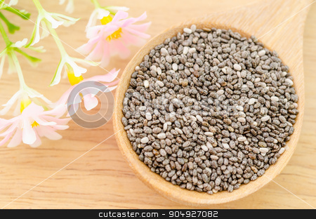 Chia seeds in wooden spoon with flower. stock photo, Chia seeds in wooden spoon with flower on wooden background. by Miss. PENCHAN  PUMILA