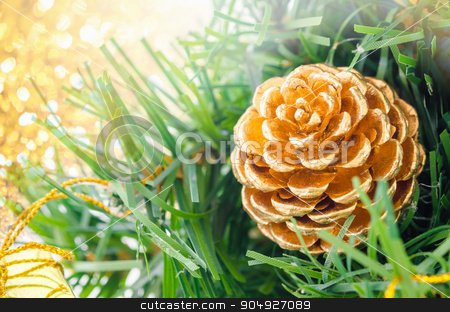 Gold Christmas background of de-focused lights. stock photo, Gold Christmas background of de-focused lights with decorated tree by Miss. PENCHAN  PUMILA