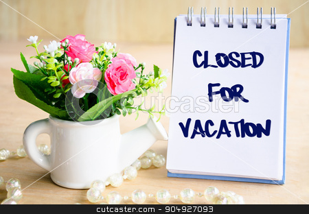 Close for vacation text.  stock photo, Close for vacation text on diary and flower on wooden background. by Miss. PENCHAN  PUMILA