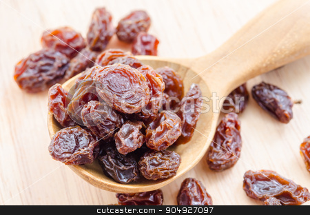 Red raisins in a wooden spoon. stock photo, Red raisins in a wooden spoon on wooden background. by Miss. PENCHAN  PUMILA
