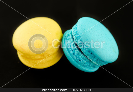 Colorful macaroon over black. stock photo, Colorful macaroon over black background by Miss. PENCHAN  PUMILA
