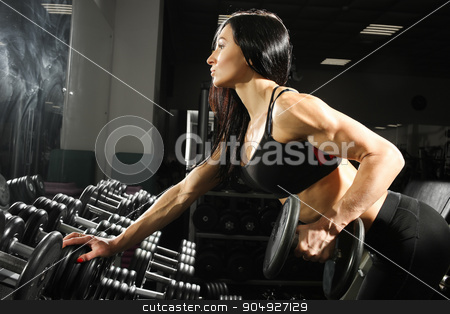 sexy woman doing workout with dumbbells  in gym. exercise for the back and triceps stock photo, Nice sexy woman doing workout with dumbbells  in gym by Kopytin Georgy