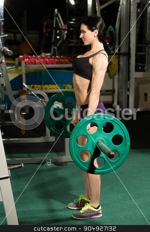 Brunette strong fitness sexy woman doing barbell squats in a gym stock photo, Brunette strong fitness woman doing barbell squats in a gym by Kopytin Georgy