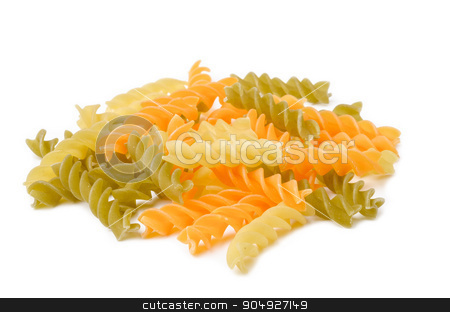 Uncooked italian pasta - three colors spirals. stock photo, Uncooked italian pasta - three colors spirals on white background. by Miss. PENCHAN  PUMILA