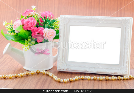 Flowers vase and vintage white picture frame on wooden desktop. stock photo, Flowers vase and vintage white picture frame on wooden desktop, clipping path by Miss. PENCHAN  PUMILA