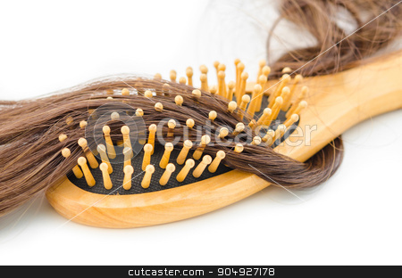 Hair loss problem stock photo, Hair loss problem concept. Wooden hair brush and hair fall on white background. by Miss. PENCHAN  PUMILA