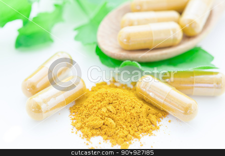 Turmeric herbal capsules with green leaf. stock photo, Close up turmeric herbal capsules with green leaf on white background. by Miss. PENCHAN  PUMILA