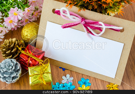Blank Christmas Greeting card with Christmas decorations. stock photo, Blank Christmas Greeting card for your text with Christmas decorations with flower on wooden background. by Miss. PENCHAN  PUMILA