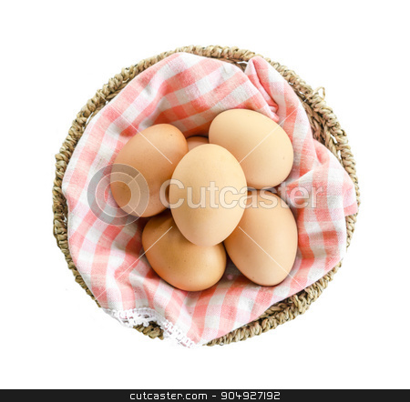 Eggs in basket. stock photo, Eggs in basket on white background. by Miss. PENCHAN  PUMILA