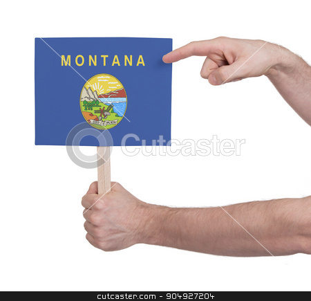 Hand holding small card - Flag of Montana stock photo, Hand holding small card, isolated on white - Flag of Montana by michaklootwijk
