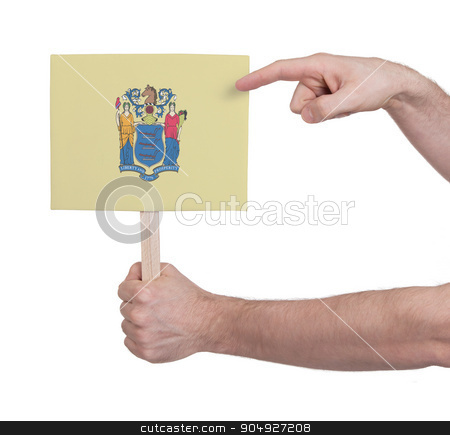Hand holding small card - Flag of New Jersey stock photo, Hand holding small card, isolated on white - Flag of New Jersey by michaklootwijk