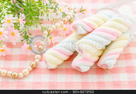 Twisted marshmallow with flower. stock photo, Twisted marshmallow with flower on tablecloth background. by Miss. PENCHAN  PUMILA