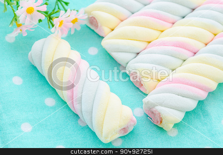 Twisted marshmallow. stock photo, Twisted marshmallow with flower on tablecloth. by Miss. PENCHAN  PUMILA