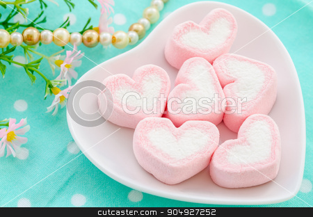 sweet heart shape of marshmallows. stock photo, sweet heart shape of marshmallows in white cup with flower on tablecloth background. by Miss. PENCHAN  PUMILA