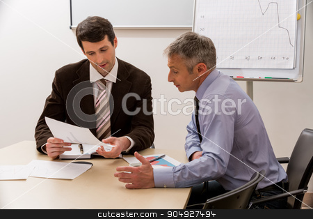 Men with interest to discuss the business plan.  stock photo, Men with interest to discuss the business plan. Managers at the meeting in the meeting room. by Denys
