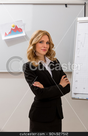 Business coach in the audience. stock photo, Business coach in the audience. Business woman at the presentation. by Denys