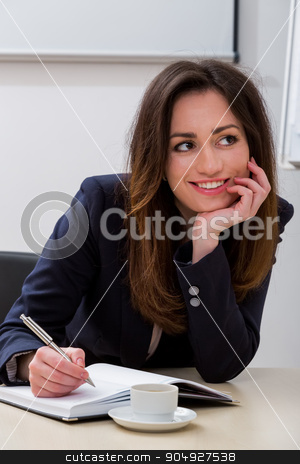 Secretary at the workplace. stock photo, Business woman in the office. Secretary at the workplace. Business conference. by Denys