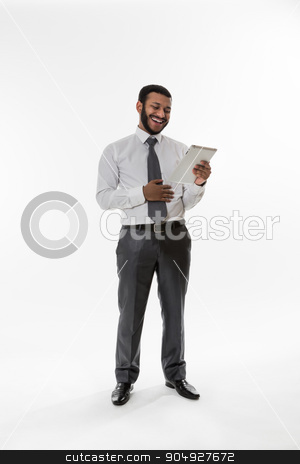 Young businessman. stock photo, Business man looking into tablet. Young businessman. by Denys