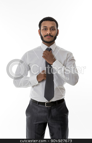 Black clerk. stock photo, Business manager straightens his tie. Black clerk in the office.  by Denys