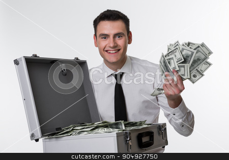 Happy manager. stock photo, Manager kicks from money. Man with suitcase full of money. by Denys
