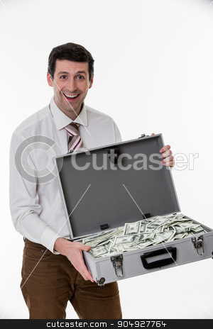 Man won the jackpot. stock photo, Surprised man with a suitcase full of dollars. Happy businessman with a suitcase of money.  by Denys