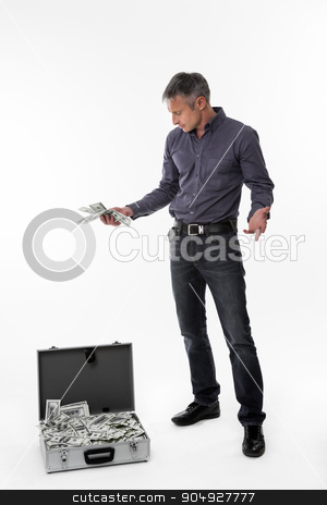 Man with suitcase full of money. stock photo,  Man with suitcase full of money. Manager pleasantly surprised the suitcase of money. by Denys