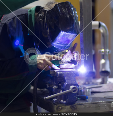 Industrial worker welding in metal factory. stock photo, Industrial worker with protective mask welding inox elements in steel structures manufacture workshop. by kasto