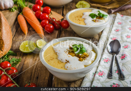 Creamy celery soup stock photo, Celery soup with homemade whipped cream, baked potatoes and homemade bread by Peteer