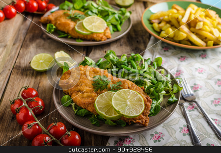 True Viennese schnitzel stock photo, True Viennese schnitzel with little salad and lime, french fries and beautiful cherry tomatoes by Peteer