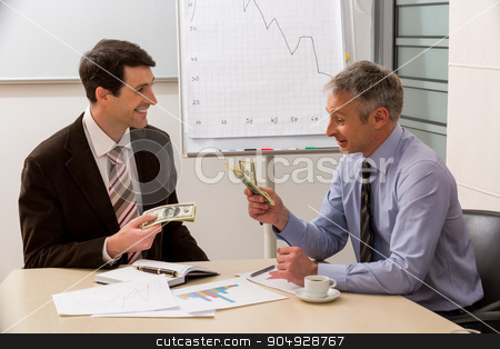Businessmen count the money. stock photo, Businessmen count the money.Businessmen share the profit.  by Denys