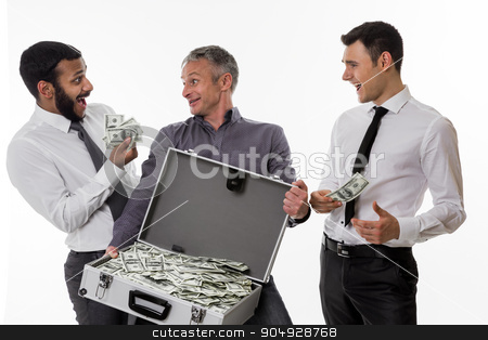 Successful people. stock photo, Young people with a suitcase full of money. Businessmen have earned a lot of money. by Denys