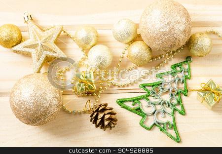 Golden Christmas decorations. stock photo, Golden Christmas decorations on wooden background. by Miss. PENCHAN  PUMILA