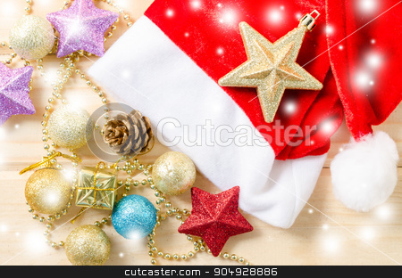 Christmas holiday background with Santa hat and decorations. stock photo, Christmas holiday background with Santa hat and decorations with snow. by Miss. PENCHAN  PUMILA
