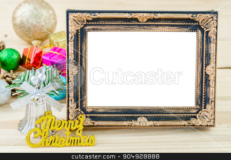 Vintage blank photo frame with christmas decorations on wood bac stock photo, Vintage blank photo frame with christmas decorations on wood background. Save clipping path. by Miss. PENCHAN  PUMILA