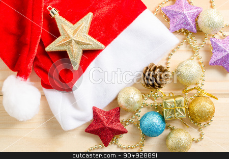 Christmas holiday background with Santa hat and decorations. stock photo, Christmas holiday background with Santa hat and decorations on wooden background. by Miss. PENCHAN  PUMILA