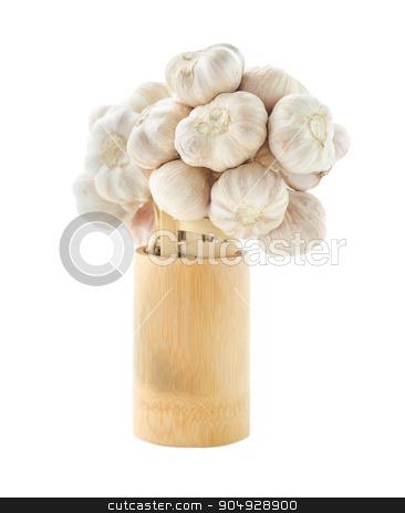 Fresh garlic in wooden cup. stock photo, Fresh garlic in wooden cup on white background. by Miss. PENCHAN  PUMILA