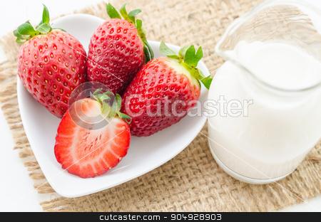 Strawberries and milk drink. stock photo, Fresh Strawberries and milk drink on sack background. by Miss. PENCHAN  PUMILA