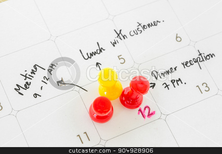 Pushpin on calendar with busy day. stock photo, Pushpin on calendar with busy day overworked schedule. by Miss. PENCHAN  PUMILA