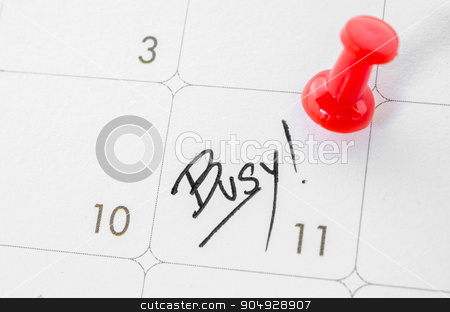 The words Busy written on a white calendar. stock photo, The words Busy written on a white calendar to remind you an important appointment. by Miss. PENCHAN  PUMILA