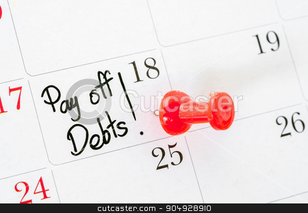 The words Pay off Debts written. stock photo, The words Pay off Debts written on a Calendar by Miss. PENCHAN  PUMILA