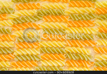 Color penne pasta. Tomato, spinach and wheat pastas. stock photo, Color penne pasta. Tomato, spinach and wheat pastas texture as background. by Miss. PENCHAN  PUMILA