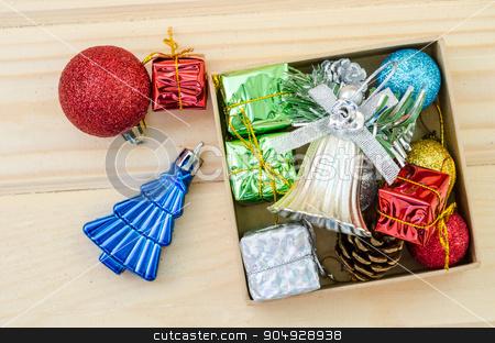 Christmas decoration in box. stock photo, Christmas decoration in box on wood background. by Miss. PENCHAN  PUMILA