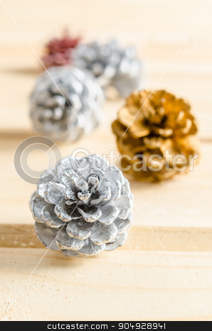 Christmas, decoration with pine cones silver. stock photo, Close up christmas, decoration with pine cones silver. by Miss. PENCHAN  PUMILA