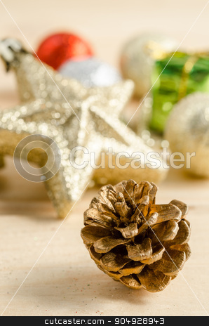 The gold cones with christmas decorations. stock photo, The gold cones with christmas decorations on wood background. by Miss. PENCHAN  PUMILA