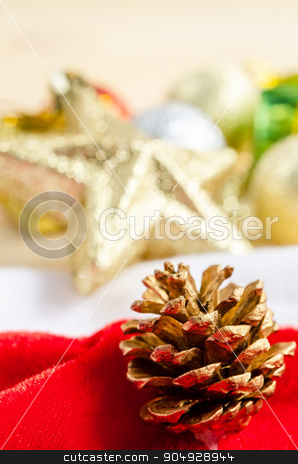 Close up gold pine cones with christmas decorations. stock photo, Close up gold pine cones with christmas decorations on wood background. by Miss. PENCHAN  PUMILA