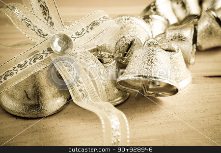 Christmas decoration. Silver bell. stock photo, Christmas decoration. Silver bell in vintage background. by Miss. PENCHAN  PUMILA