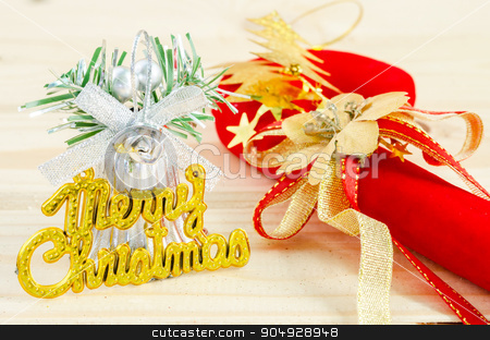 Merry Christmas on wooden background. stock photo, Beautiful Christmas decorations on table on wooden background by Miss. PENCHAN  PUMILA